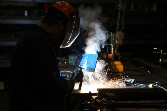 Welder at Track Machines Facility